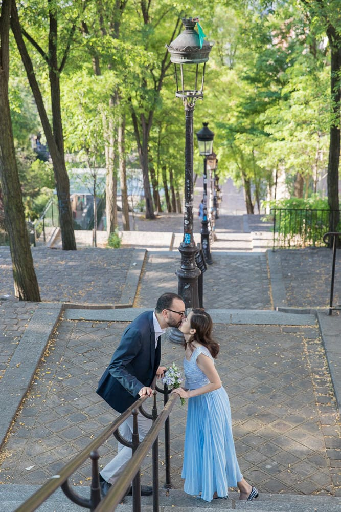 Paris pre wedding kiss on stairs Montmartre