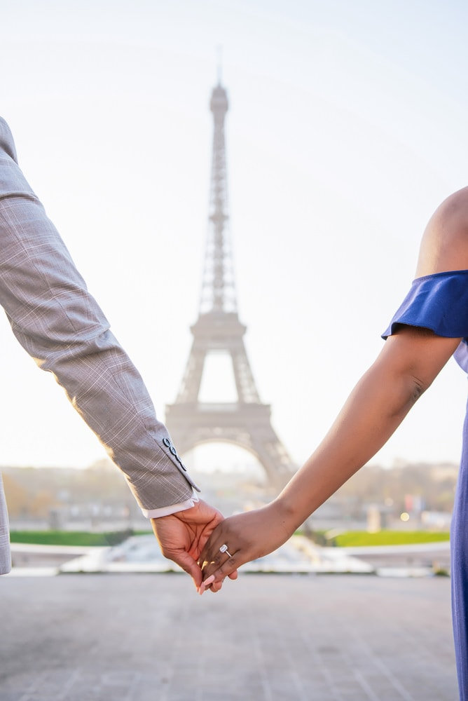 Close-up of engagement ring and hands holding at Trocadéro