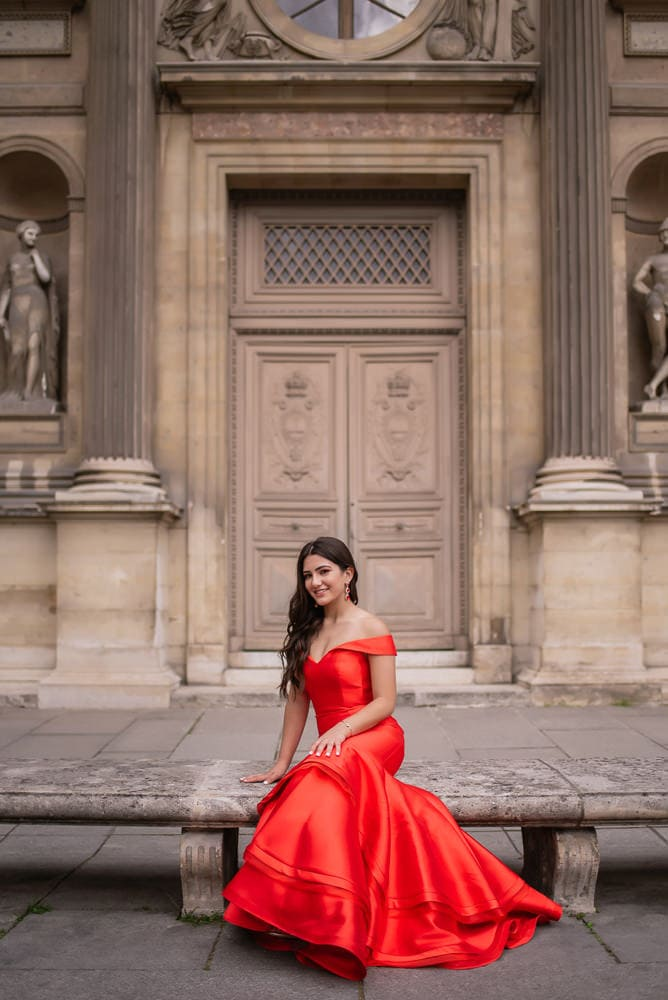 beautiful girl posing in red dress for quinceanera photo shoot