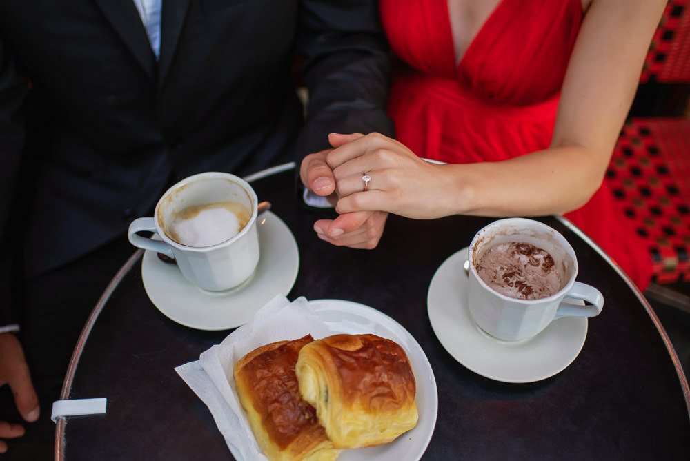 Croissants cappuccino and hot chocolate with engagement ring in Paris