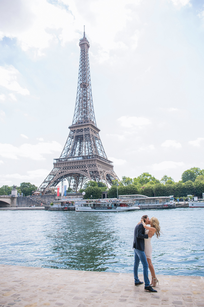 Romantic kiss by the river and Eiffel tower in paris