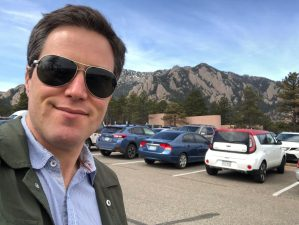 Tony Jordan at the National Center for Atmospheric Research parking lot with majestic foothills in background.