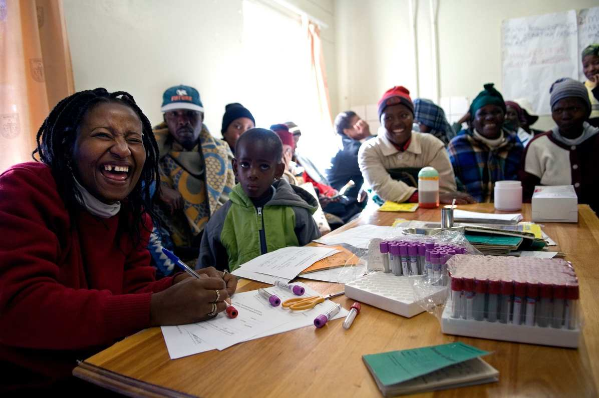 P36. A lighter moment at the Teyateyaneng Hospital ARV Clinic where Miriam Mamotete, 31, herself HIV positive, works to help patients. A study commissioned by The World Health Organization revealed that the infrastructure necessary to stem the spread of AIDS does not require extensive facilities but can be effectively administered through small clinics and dispensaries.
