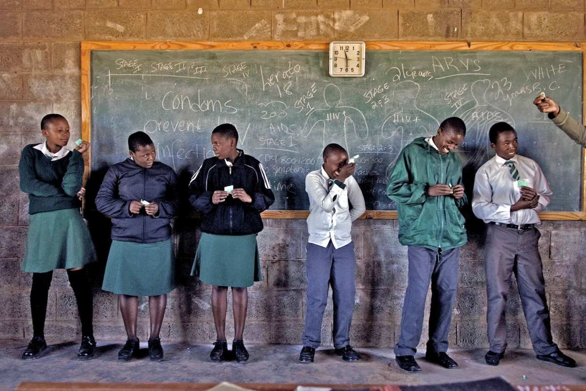 Mahobong Secondary School, Leribe District, Lesotho-May 11-2006: Peace Corps Volunteer Jean Margaritis and Tsepo Rameane a youth counsellor discuss HIV and Aids with Grades 8-10 students. The school has about 130 students. 60 to 70 per cent of the students are either single or double orphans in the 8th grade class. 