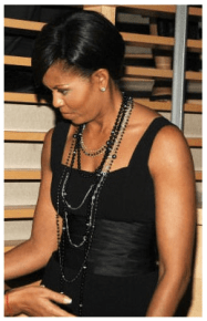 Michelle Obama wore pearls almost all the time during her husband's time in office. Here she's sporting ropes of black pearls.