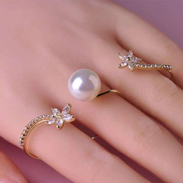 Check out this rhinestone and pearl three finger ring.