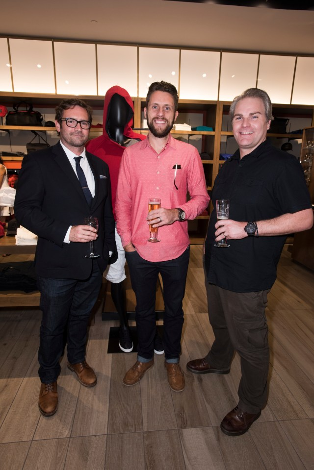 Steve Evans, Zach Brown and Marty Christiansen pose for a photo at the Armani Exchange in Dallas, Texas on September 24, 2015.
