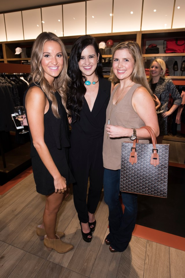 Lauren Sims, Ellen Flowers and Chandler Hatchett pose for a photo at the Armani Exchange in Dallas, Texas on September 24, 2015.
