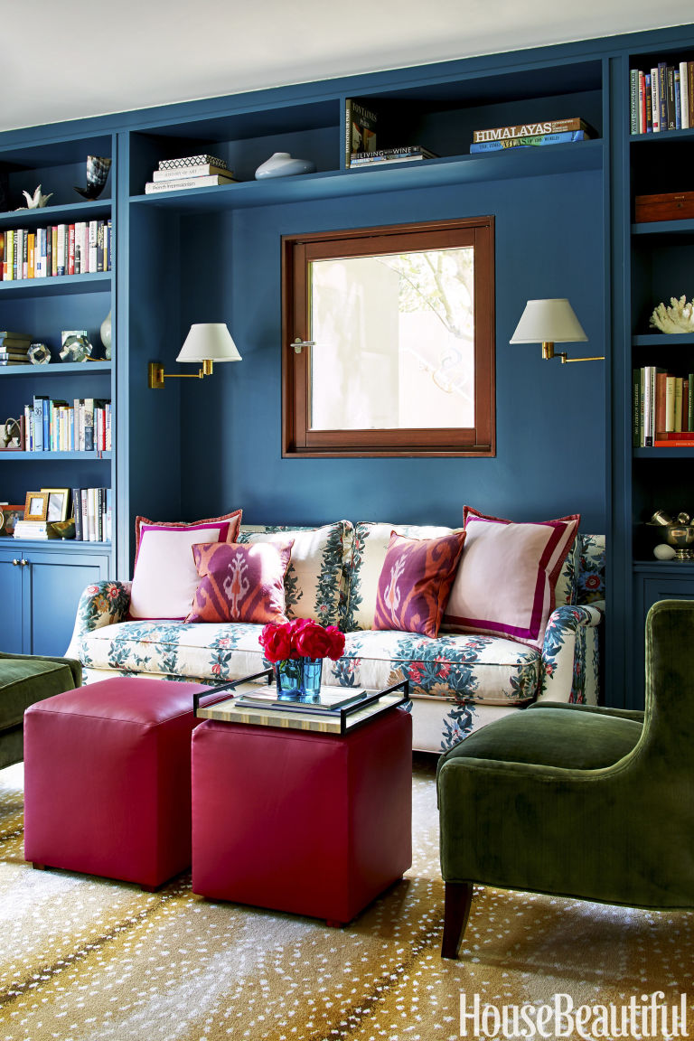blue-bookshelf-floral-couch-pink-antelope-rug