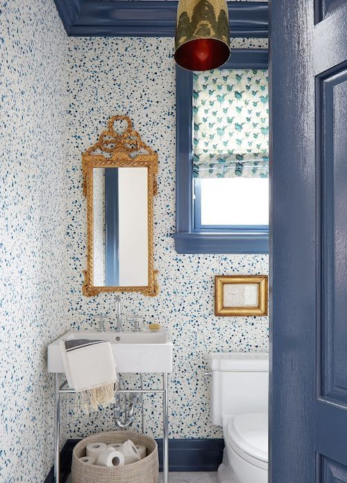 blue and white wallpaper guest bathroom
