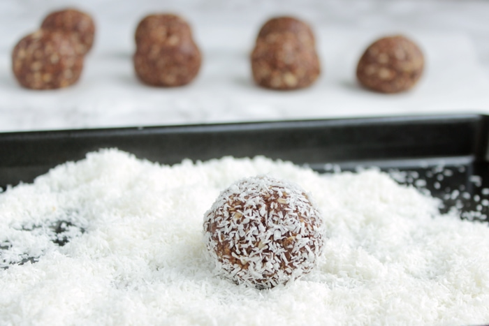 Swedish Chocolate Balls, close up of ball rolled in coconut flour, other balls in the background