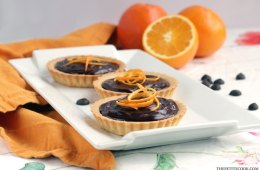 This delicious Mini Jaffa Tarts give a new twist to a classic British treat. The indulgent chocolate and orange combo makes a great dinner party dessert. Recipe from thepetitecook.com