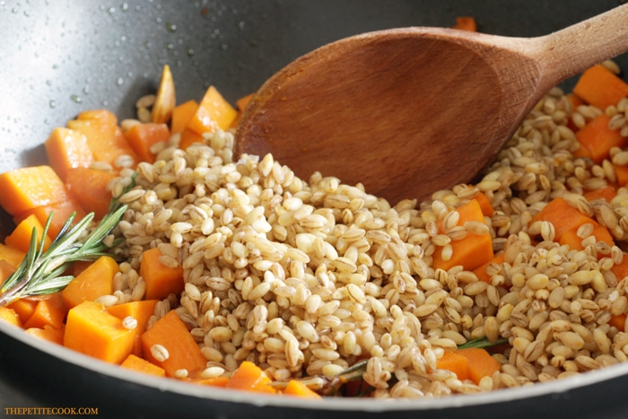 This Barley Risotto with Pumpkin and Rosemary is vegan and dairy-free but incredibly flavorful and hearty. One of those comfort food you can't possibly feel guilty about! Recipe from thepetitecook.com