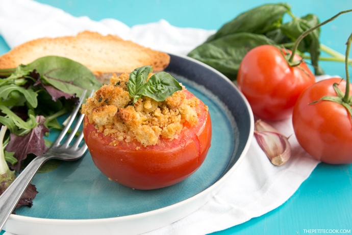 Baked Tomatoes are quick and simple to make and burst with fresh aromatic flavours - An easy side dish or appetizer that will please the entire family! Vegetarian recipe from thepetitecook.com