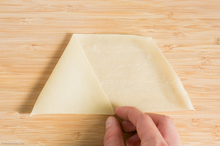 samosas recipe step 1: fold the pastry sheet using your hand, to form a triangle