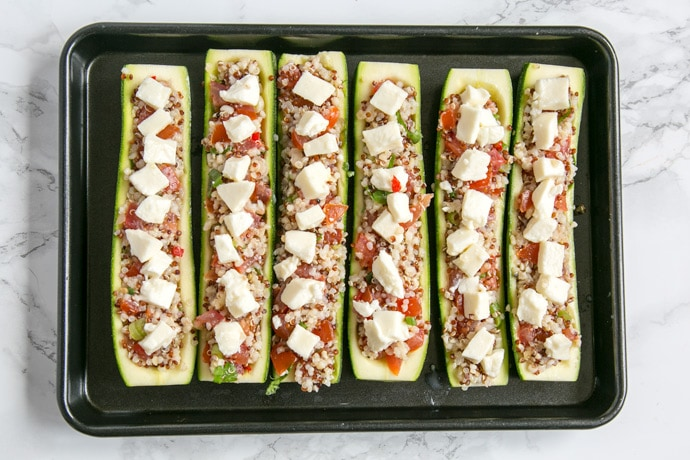 A simple filling of quinoa, pico de gallo and melted mozzarella cheese make these stuffed zucchini boats a delicious, satisfying vegetarian summer side dish. Ready in just 30 min - Naturally gluten-free - Skip out the cheese to make it vegan! Recipe from thepetitecook.com
