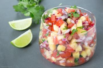 A delicious combo of sweet & spicy flavors makes this Easy Pineapple Salsa just the perfect side for any grilled meat or fish! Recipe from thepetitecook.com