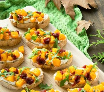 Give a fall twist to the classic Italian Bruschetta - These warm, crunchy vegetarian Roasted Pumpkin and Ricotta Bruschetta make a great seasonal appetizer for your holiday dinner parties. Recipe by The Petite Cook
