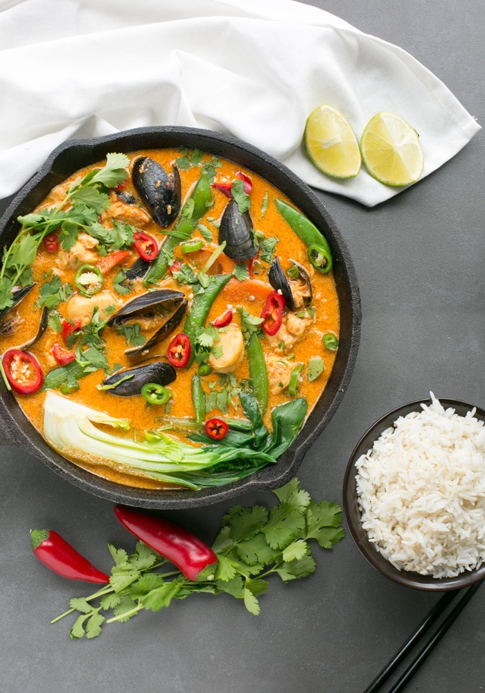 This vibrant spicy Thai Red Fish Curry is ready in less than 30 min and makes a fantastic light option for a quick balanced meal. Plus it's also dairy-free and gluten-free! Recipe from The Petite cook - www.thepetitecook.com