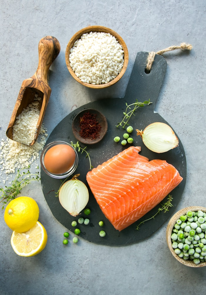 The ingredients list is short, and made of simple ingredients such as: fresh salmon, frozen peas, risotto rice, panko breadcrumbs, eggs, onion, lemon zest, saffron and thyme.