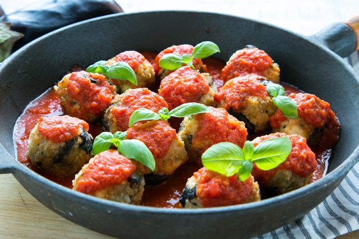 These hearty Vegetarian Aubergine Meatballs with Feta Cheese are packed with Mediterranean flavour. Ready in just 30 min, they make an impressive, tasty meal and require only few simple fresh ingredients! Recipe by The Petite Cook
