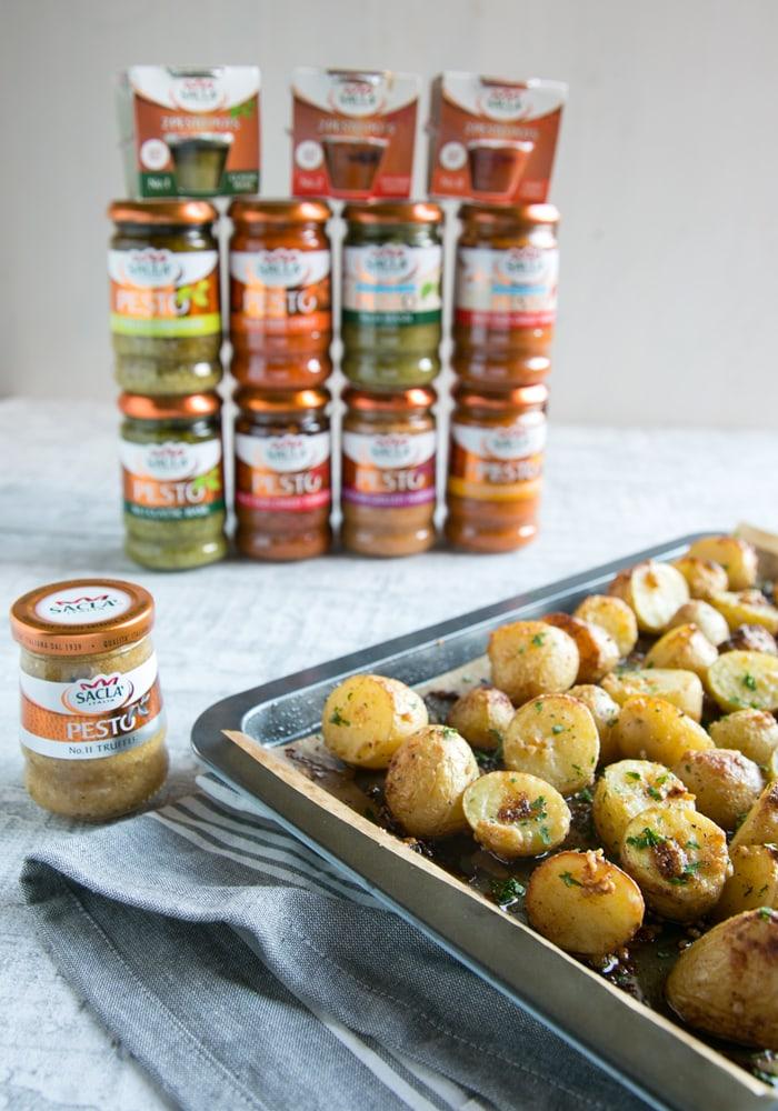 Truffle Pesto Roasted Potatoes next to Sacla pesto jars