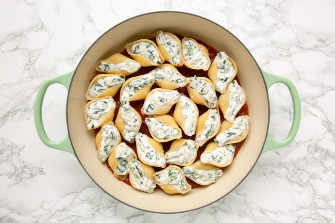 recipe step 2: Spinach and Ricotta Stuffed Pasta Shells on a bed of tomato sauce
