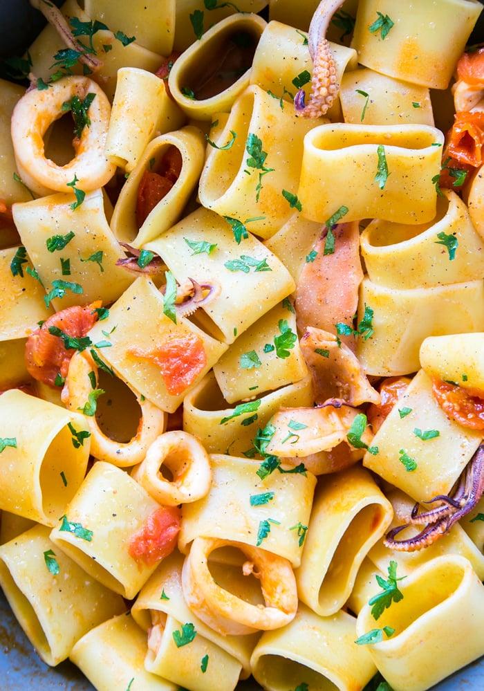 calamarata pasta with calamari and tomato sauce