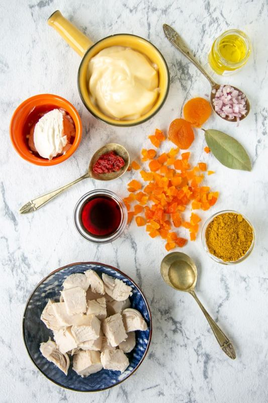 coronation chicken ingredients on a marble board