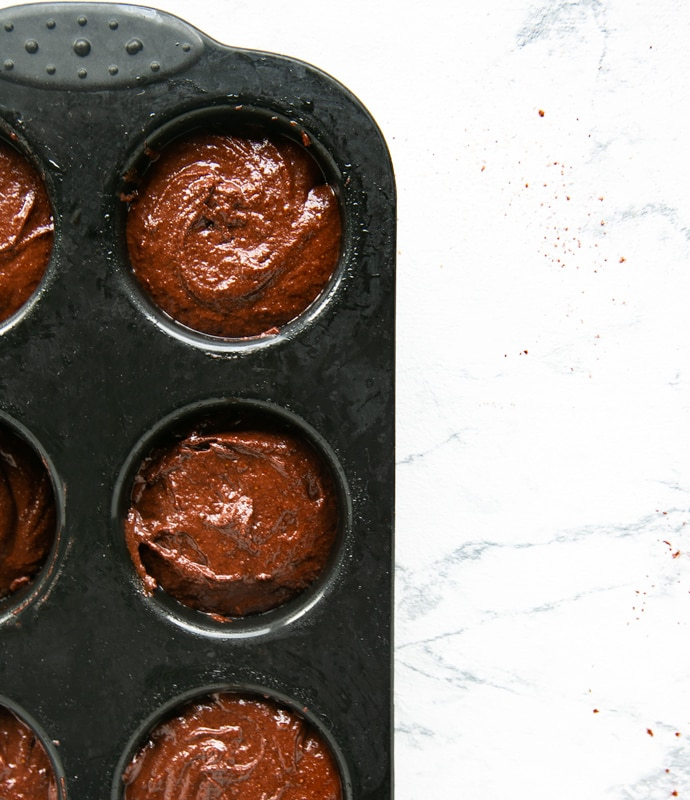 muffins recipe step 6: batter divided among black muffin tin