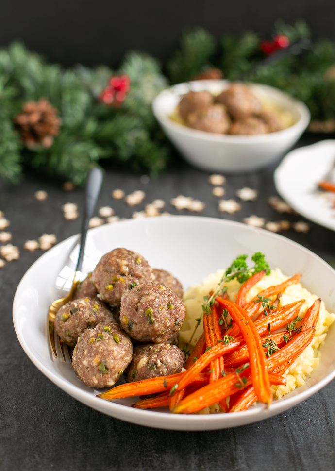 pistachio lamb meatballs servedd with glazed carrots, and mashed potatoes