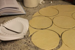cut out rounds from dough and pie maker