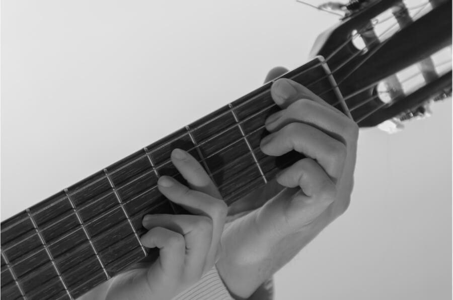 Dad and daughter practising guitar