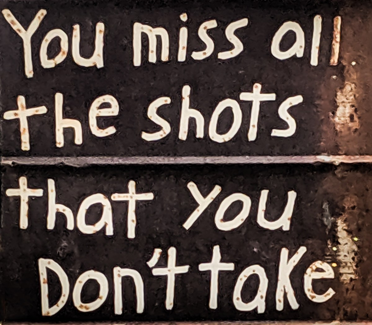 """Sign with the text, """"You miss all the shots that you don't take"""""""
