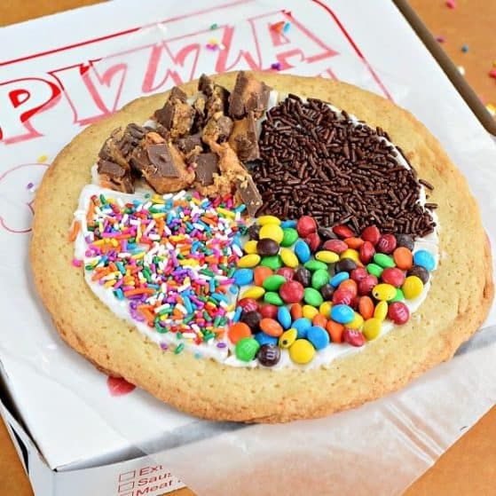 Dessert pizzas are candy and frosting on a sugar cookie. A fun summer activity to do with the kids.