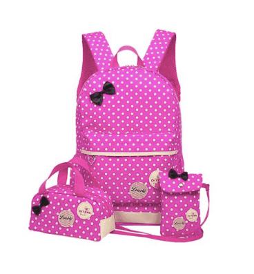 10+ Coolest Backpacks for Girls: Polka Dot Bow | www.thepinningmama.com