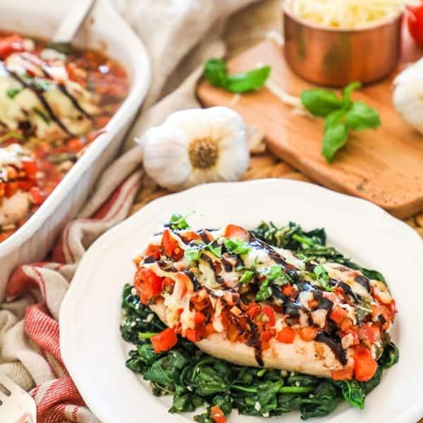 Bruschetta Chicken Bake Serve on Spinach