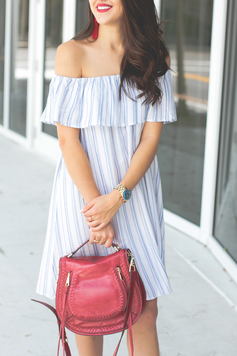 Savannah Jayne styles a blue and white striped dress with red accessories.