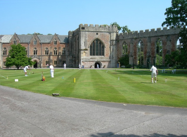 Men playing croquet in front of the bishop's palace Wells