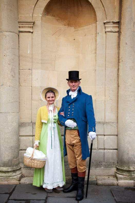 A couple wearing 18th century clothing.