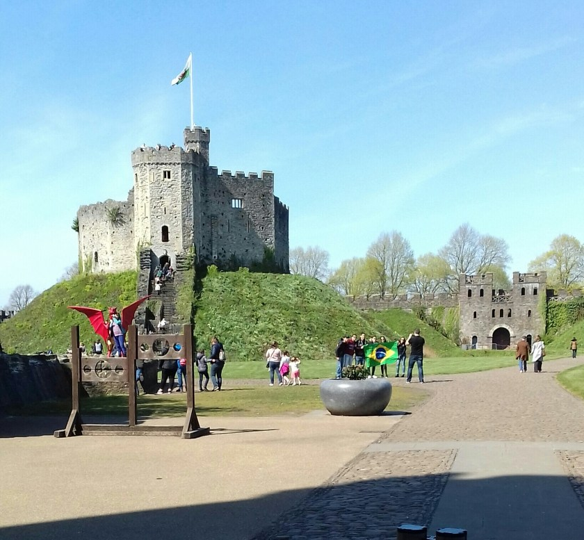 Visitors walking around the grounds of Cardiff castle