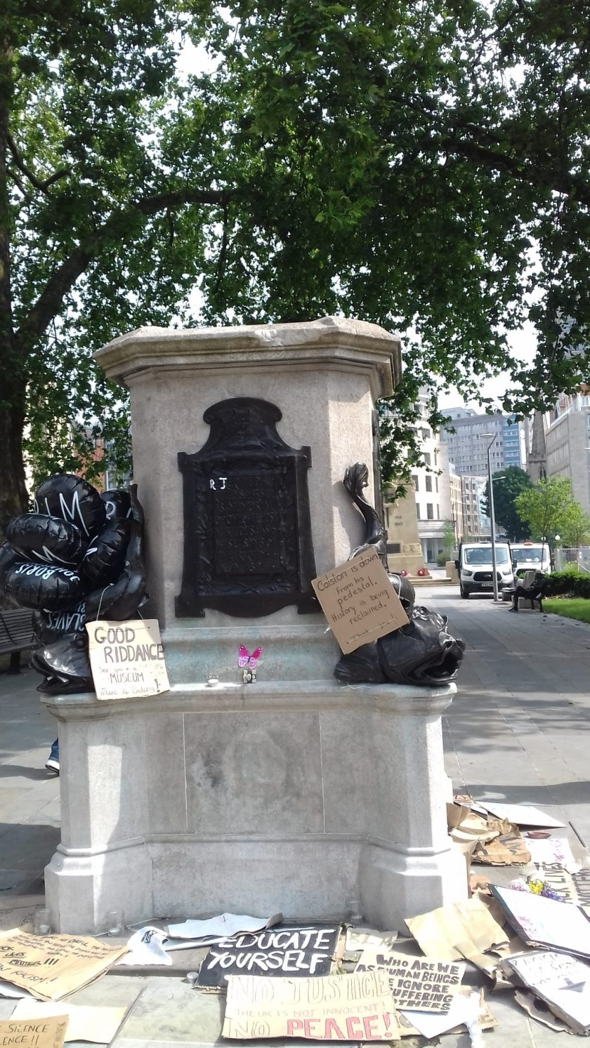 The plinth with psters reading good riddance