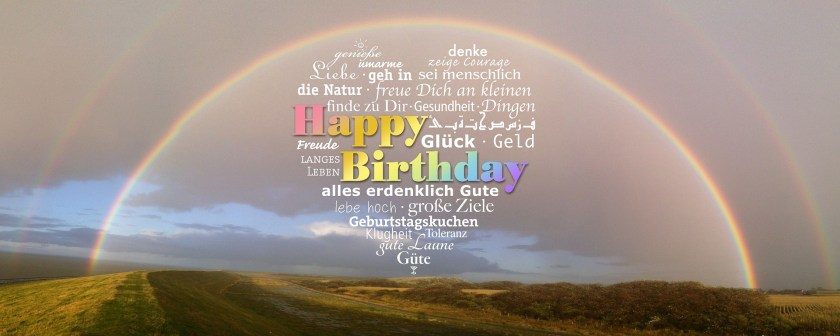 A rainbow with happy birthday written under it two celebrate two years of blogging