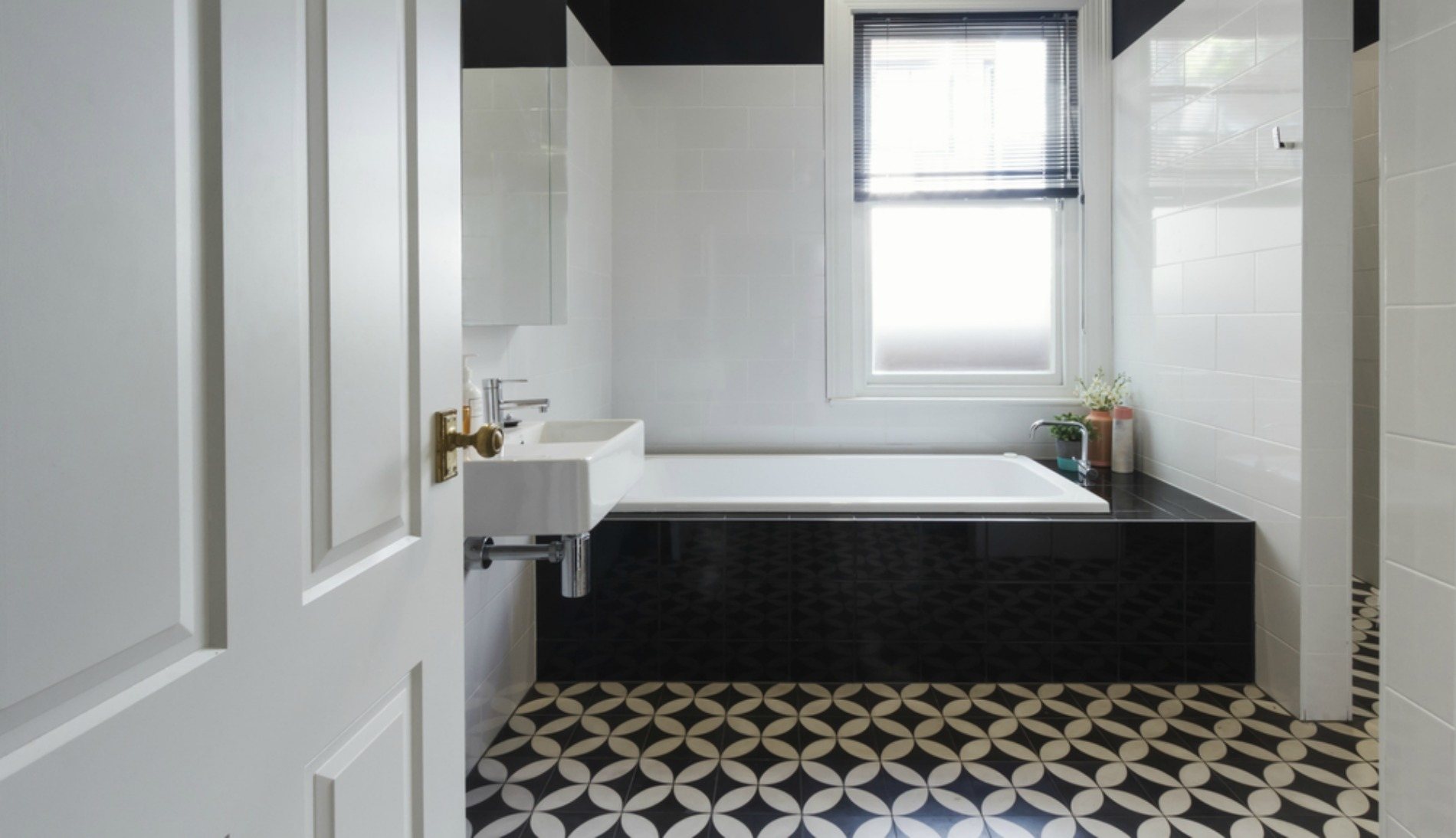 Bathrooms with Black and White Patterned Floor Tiles