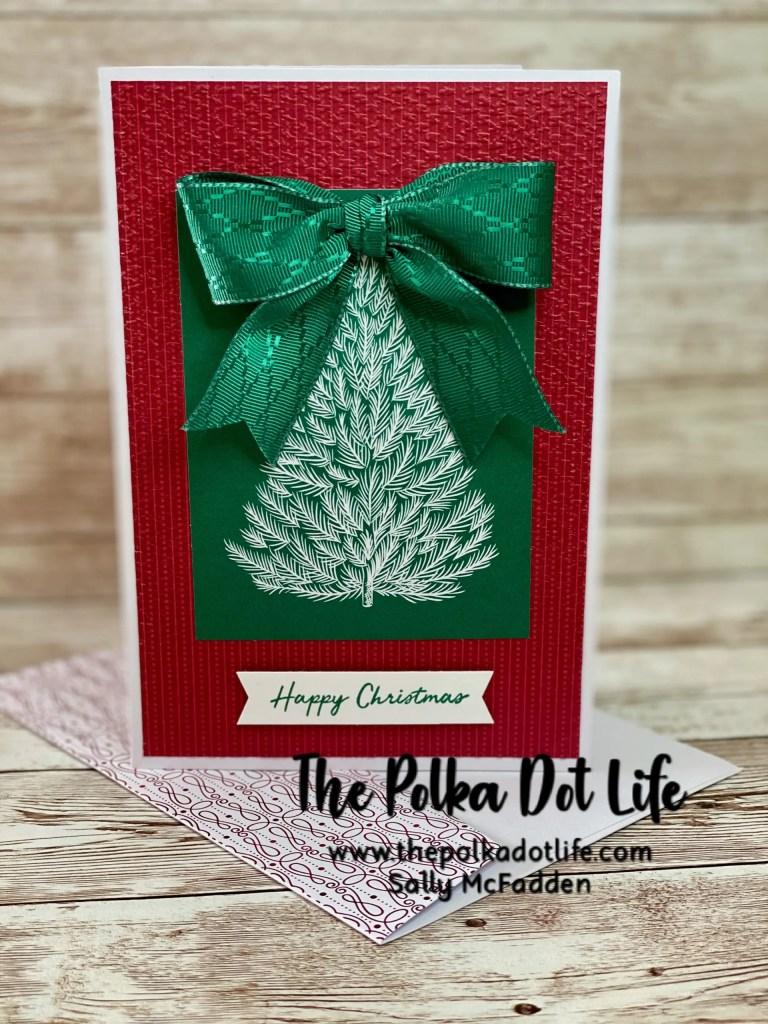 A picture of a Stampin' Up greeting card featuring a green Christmas Tree with a bow.