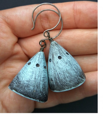 Katya Tryfonova scratched earrings