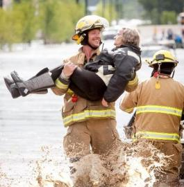 Firefighter rescues senior in High River, devastated by flooding