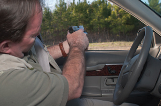 When shooting through the driver's window, you'll need to be able to make precise hits in a seated compressed Weaver position.