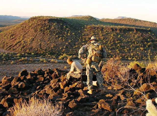 An effective security perimeter is not constrained by two dimensions.  This photo shows a surveillance LP/OP that was located on a hilltop 300 feet above and 1100 feet away from the corral shown in the previous photo.  Locations such as these can provide significant tactical advantage.  Communication between the LP/OP and camp were maintained via radio.
