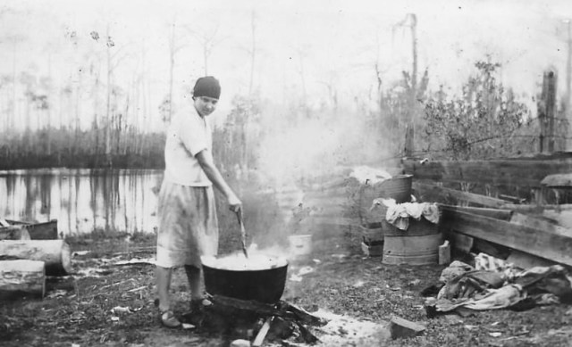 Finnish Immigrant Boiling Clothes for Wash, Near Bayou Cumbest, Mississippi. Around 1900